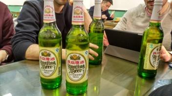 Cerveza china tamaño litrona tronco